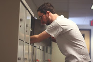 Commuter student checking his rented locker 2015
