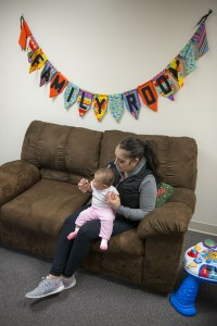 Student with child in Family Room  2015