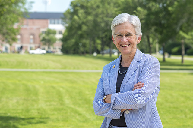 Photo of President Hunter standing on the UMaine campus mall