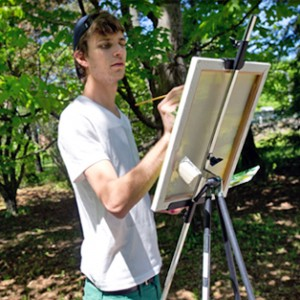 A student painter in the field
