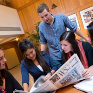 Students reading business news
