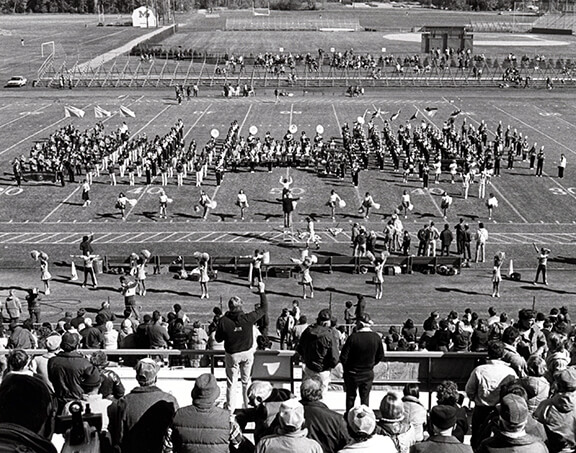 Marching band in formation on the football field, circa 1984
