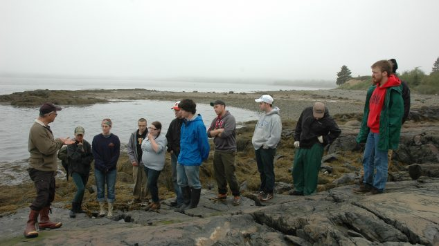 photo of Studentswith Donald Soctomah at petroglyph site
