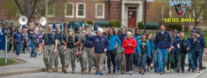 Army ROTC Cadets march with executive members of the UMaine faculty on Maine Day.