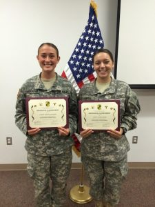 Recently commissioned 2LT's McCormick and Paneral display their Certificates of Achievement for completing NSTP.