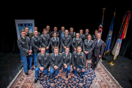 Cadets pose for a picture with United States Secretary of Defense (ret.) William Cohen.