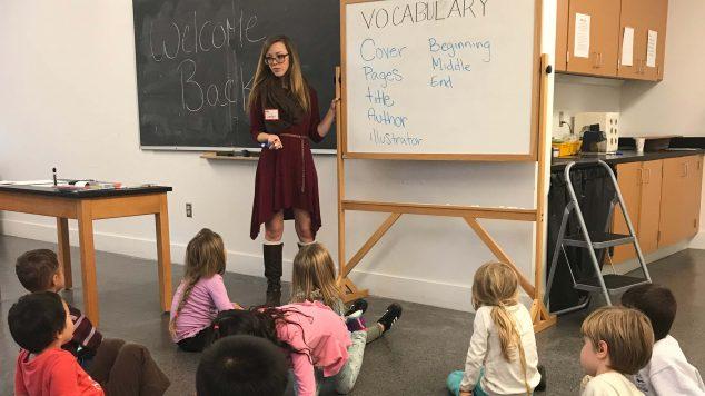 woman teaching kids art