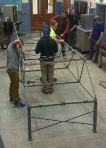 students working on a steel bridge