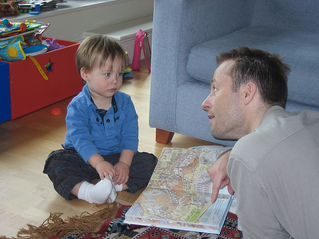 Young boy and Dad reading