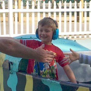 Boy with headphones riding amusement ride
