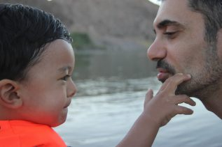 Father and young child face to face