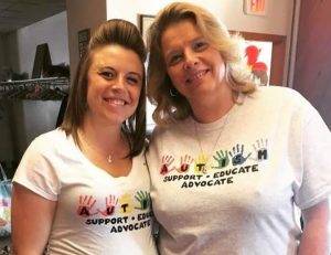 Two women smiling with Autism Awareness t-shirts