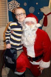 Young boy sitting with Santa