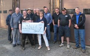 Group of auto service workers with MAIER staff and VP holding large check