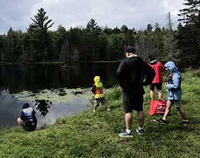 Family fishing at pond