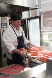 UMaine Dining employee removes freshly cooked Maine lobster