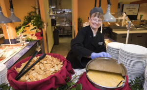 UMaine Dining employee at Taste of the World: Peru