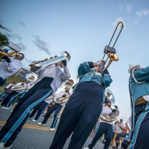 marching band trombones and baritone saxophones doing horn swings