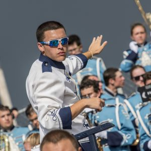 drum major conducting the marching band