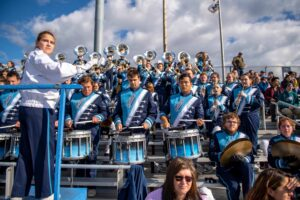 student conductor leads UMaine marching band