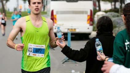 Water being handed to a runner.