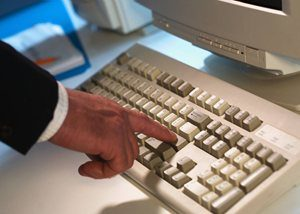 Stock photo of hand and computer keyboard