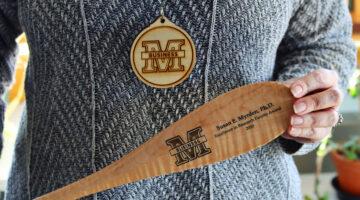 New tradition: Award paddles and woodallions