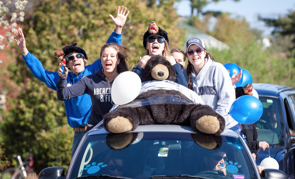Students riding in a truck on Maine Day