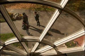 View of students through university window