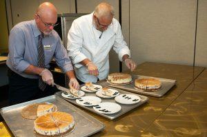 Workers preparing dessert plates