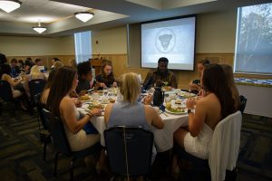 Student athletes eating during Black Bear event