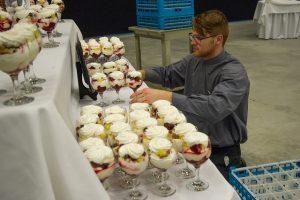 Worker arranging desserts
