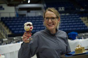 Worker holding desserts