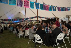Tented event with people sittling during dinner