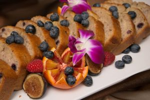 Berry bread on plate with garnish