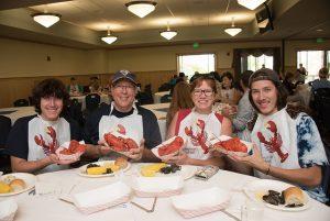 People eating lobster