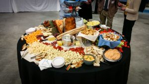 table with assorted fruit, cheeses, crackers