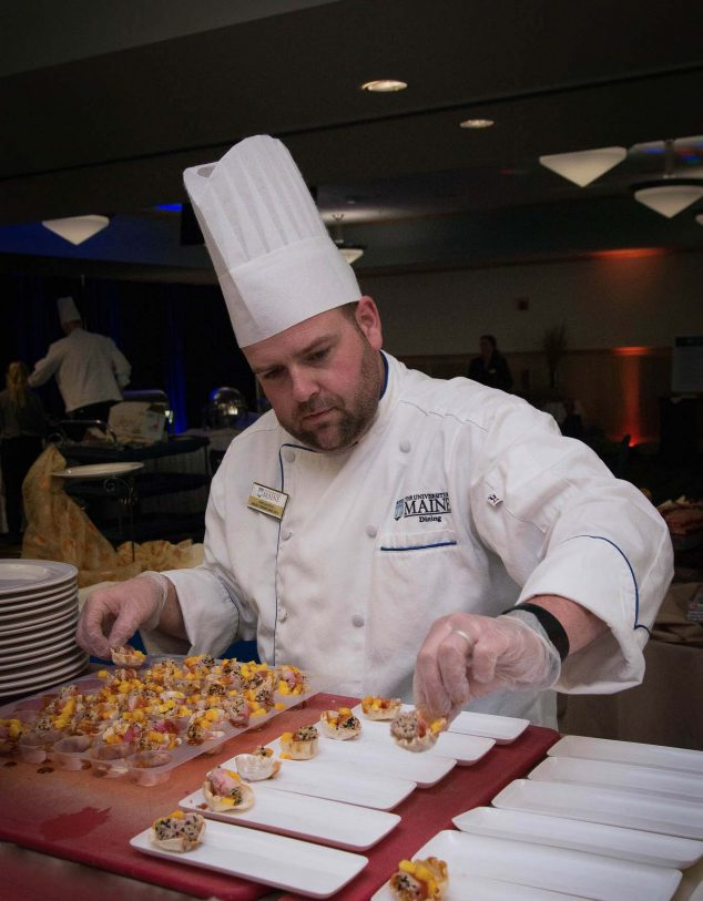 Catering chef placing appetizers on plates