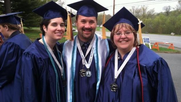 Non Trad Grads  proudly wearing their Non Trad Graduation medallion
