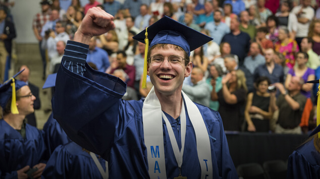 Graduate with fist in the air