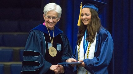 President Susan J. Hunter with graduating student
