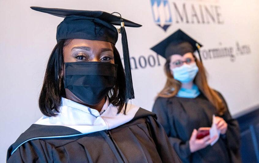 University Graduate students prepare for stage walk