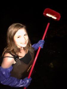 CCAR Intern Hannah with a scrub brush