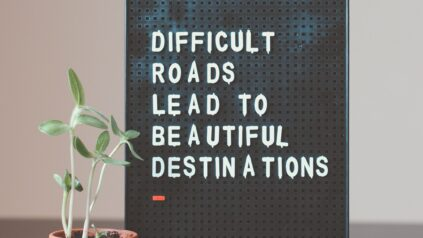 "ID a canvas board with words ""difficult roads lead to beautiful destinations"""