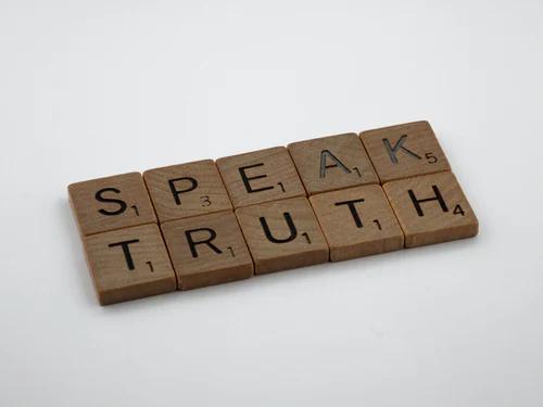 "ID: Scrabbles that Says ""SPEAK TRUTH"""