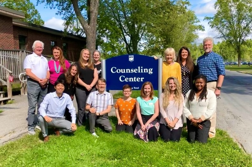ID: All Members of the Counseling Center Standing in front of the Counseling Center sign outside of the Counseling Center