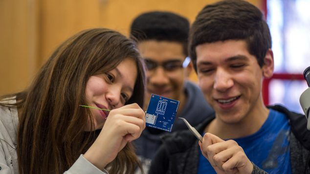 photo of students looking at computer chip