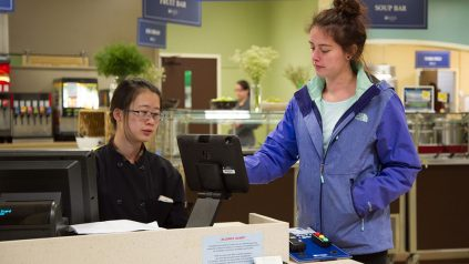 Student swiping MaineCard at York Dining