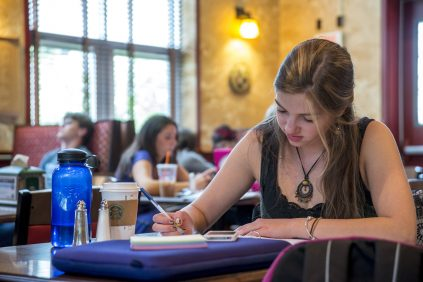 student studying at the Bear's Den Cafe & Pub