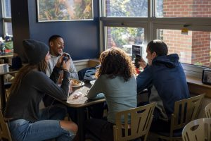 Students eating in Bear's Den, Memorial Union, University of Maine